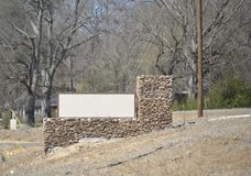 Develper Planned Suburb Development. A community marker sits at the entrance of a  community planned neighborhood and built by a homebuilding developer in a Stock Photo