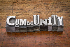 Community in metal type. Community word in mixed vintage metal type printing blocks over grunge wood royalty free stock images