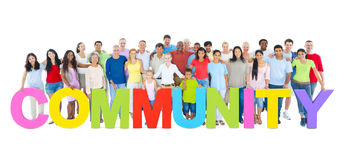 Community. Multi-ethnic group of people holding COMMUNITY letters stock photography