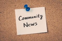 Community News. Concept message on a cork board Royalty Free Stock Photo