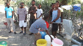 Community Pumping Water at Well stock video