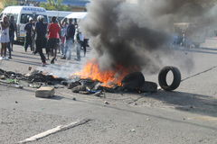 Community staging a protest blocking a road during a taxi strike in Durban South Africa Royalty Free Stock Photography
