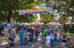 Community Street Festival. MATTHEWS, NC - September 4, 2017: Crowds of people walk among vendors offering arts and crafts at the 25th `Matthews Alive` street royalty free stock images