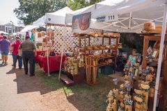 Community Street Festival. MATTHEWS, NC - September 4, 2017: Vendors offer arts and crafts to attendees of the 25th annual `Matthews Alive` street festival royalty free stock photos