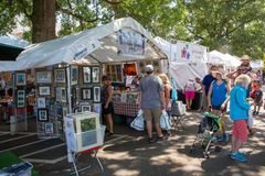 Community Street Festival. MATTHEWS, NC - September 4, 2017: Vendors offer arts and crafts to attendees of the 25th annual `Matthews Alive` street festival stock images