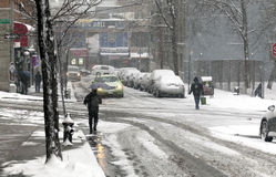 Community street during snow storm Stock Image