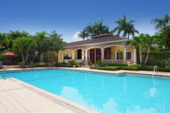 Community swimming pool. Image of a housing community swimming pool with palm trees Stock Photo