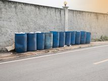 The community trash can be found on the side of the road for easy access. stock photos