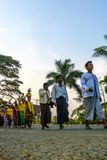 Community was line up going to temple, Mrauk u Myanmar on April 04, 2016 royalty free stock image