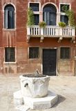 Community Well. Well in front of a building in venice italy Stock Photo