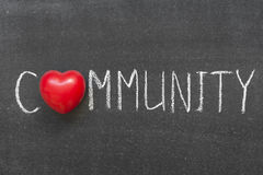Community. Word handwritten on chalkboard with heart symbol instead of O stock photos