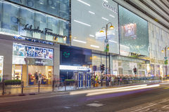 Communters outside luxury brand stores in Hong Kong. Hong Kong, China - June 13, 2015: Communters or shoppers waiting to cross the Canton Road with luxury brand Royalty Free Stock Photo