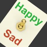 Commutateur triste heureux Photographie stock