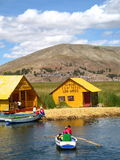 Commute to School. Children going to school in Lake Titicaca Stock Photos