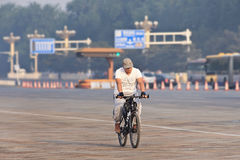 Commuter on a bike in the early morning, Beijing, China. Royalty Free Stock Photos