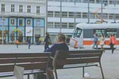 Commuter on city bench Royalty Free Stock Photography