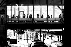 Commuter Culture. Morning commuter traffic at Leeds railway Station with passengers on walkway Royalty Free Stock Photos