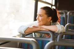 Commuter daydreaming bus. Pretty female commuter daydreaming on bus stock image