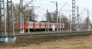 Commuter electric train arrives at the station. April  2, 2018 St. Petersburg, Russian Railways, commuter electric train arrives at the station stock video