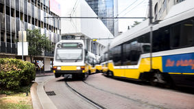 Commuter light rail trains passing on a curve Stock Photos