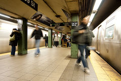 Commuter passengers in subway station Stock Image