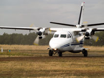 Commuter plane on taxiway. Small turboprop commuter plane rolling on taxiway Stock Photos