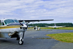 Commuter planes in airfield Stock Photography