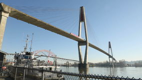 Commuter Rail Bridge, Fraser River, New Westminster. A commuter rail bridge crosses the Fraser River at New Westminster. British Columbia, Canada stock footage