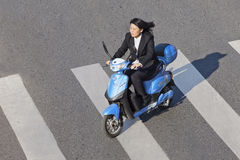 Commuter on a scooter, Beijing downtown. Stock Photos