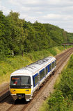 Commuter service. BEACONSFIELD, UK - JUNE 25: A Chiltern Railways outer London suburban passenger train service heads northward on June 25, 2014 in Beaconsfield Royalty Free Stock Images