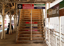 Free Commuter Sits On A Bench At Chicago&x27;s Elevated El Train Platform Near A Set Of Stairs At The Adams/Wabash Stop In Chicago Royalty Free Stock Photos - 89348128