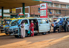 Commuter taxi. Kampala, Uganda - September 2015 - Passengers wait for a commuter taxi to fill up before they set off for their destination. 14-seater commuter Royalty Free Stock Photography