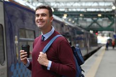 Commuter about to jump into a train.  stock photo