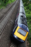 Commuter train. A train carrying commuters, slightly motion blurred Stock Photos