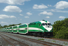 Commuter train. Green commuter train against a blue sky Royalty Free Stock Photos