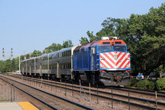 Commuter train. Double-decker commuter train approaching the station in the suburbs Royalty Free Stock Photo