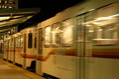 Commuter Train. A commuter train pulls away from the terminal at night Stock Images