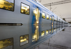 Commuter train. A commuter train reflected in the wet platform. The photo was taken  in the early fall in a suburb to Stockholm, Sweden Royalty Free Stock Photo
