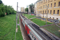 Commuter train at city railway line Stock Photo