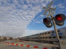 Commuter train at crossing. Chicago commuter train at rail crossing Royalty Free Stock Photos