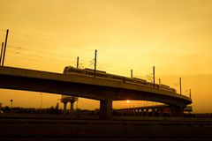 Commuter train on elevated track Stock Photo