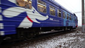 Commuter train-express arrives to Moscow. Commuter train-express with dog logotype arrives to Moscow stock video