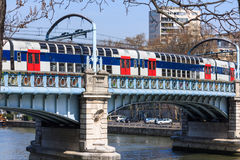 Commuter train. A French doubledecker train crossing the river Seine in Paris, France Royalty Free Stock Image