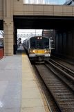 Commuter Train Line. Commuter Line with a Train Pulling into the Tracks Stock Photo
