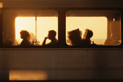 Commuter Train with Passengers. Silhouetted Metrorail Commuters at sunrise, Washington D.C Royalty Free Stock Photos