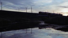 Commuter Train Passes Over The Railway Bridge On Sunrise, Trans-Siberian Railway. Full HD Resolution 1920x1080 Video Frame Rate 29.97 Length 0:23 stock footage