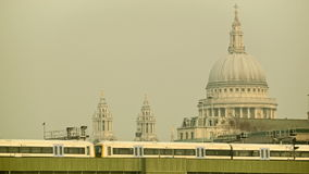 Commuter train passing by, St Paul's cathedral in the background. Train passing from Cannon Street station. In the background the St Paul's Cathedral, an iconic stock video