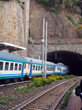 Commuter train railroad  station built through mountain Cinque T Stock Photo