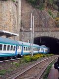 Commuter train railroad  station built through mountain Cinque T Stock Photo