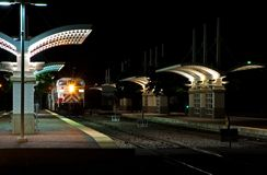 Commuter Train Station at Night. Open air commuter train station at night royalty free stock photography